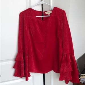 Red flare sleeved ruffle top
